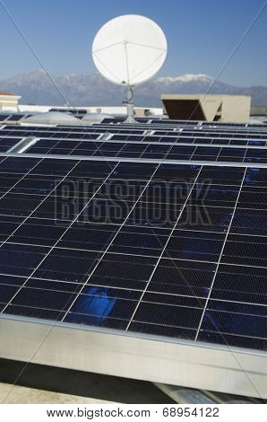 Solar panels and satellite dish at solar power plant