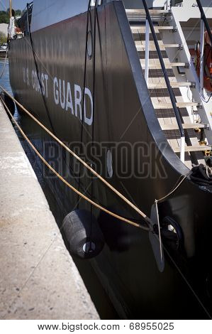STATEN ISLAND, NY - MAY 25, 2014: Words US Coast Guard written on the side of the USCGC Katherine Walker (WLM 552) Keeper Class buoy tender and mooring lines to Sullivans Piers during Fleet Week NY.