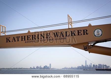 STATEN ISLAND, NY - MAY 25, 2014: The insignia of the USCGC Katherine Walker (WLM 552) written on the orange boom with the New York skyline in the background from Sullivans Piers during Fleet Week NY.