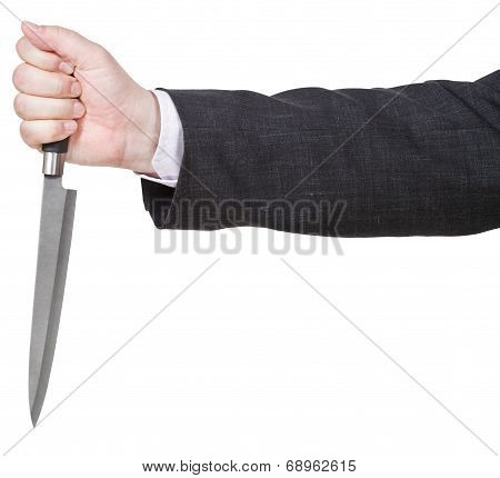 Side View Of Knife In Male Hand
