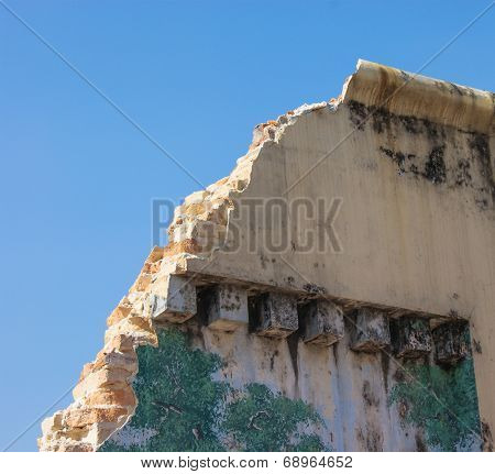Crumbling Prison Wall