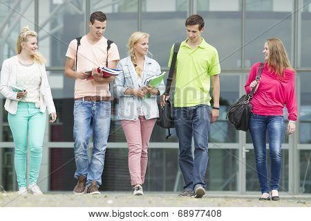 Five Students Walking With Their School Supplies