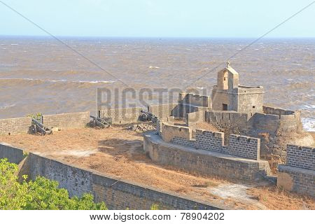 cannons pointing seawards in this immaculately well maintained fort with lighthouse was built by Bahadur Shah the Sultan of Gujarat for the Portuguese during their colonial rule of Diu island.its one of only a few in india facing the sea poster