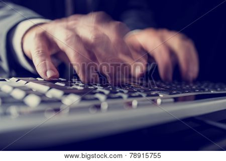 Retro image of a businessman typing on a computer keyboard inputting data with motion blur. poster