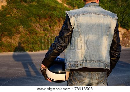 Biker On The Edge Of The Road