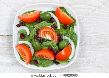 Close Up Top View Of Fresh Salad In Plate On White Wood