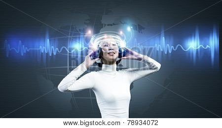 Young woman in white wearing headphones. High-tech concept poster