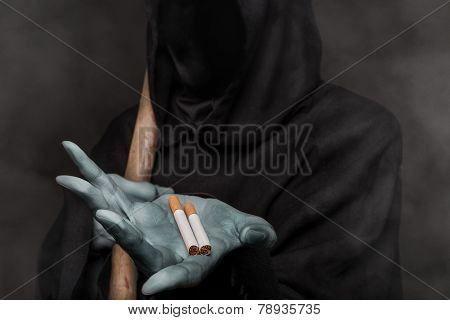 The concept: smoking kills. Grim reaper holding cigarette