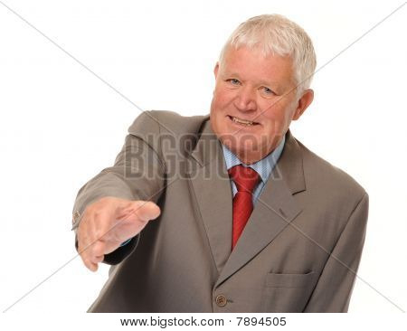 Successful Mature Businessman Offering Handshake