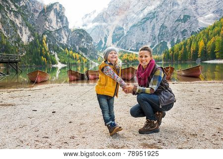 Portrait Of Happy Mother And Baby On Lake Braies In South Tyrol, Italy