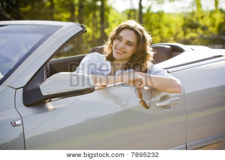 Woman Is Sitting In A Car