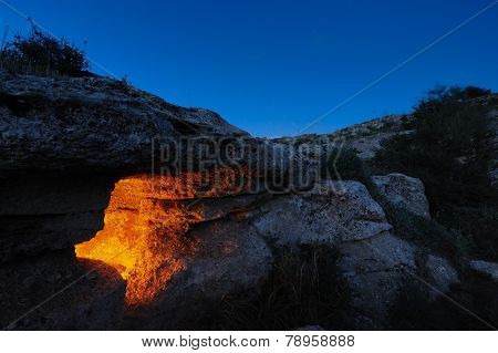 Rocky necropolis at dusk