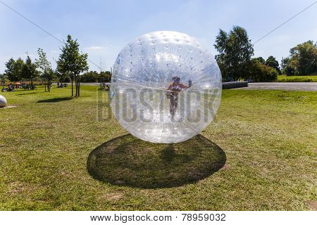 Child Has Fun In The Zorbing Ball