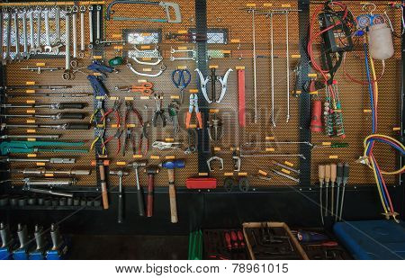 hand tool kit object arrangement on car auto service and maintenance wall