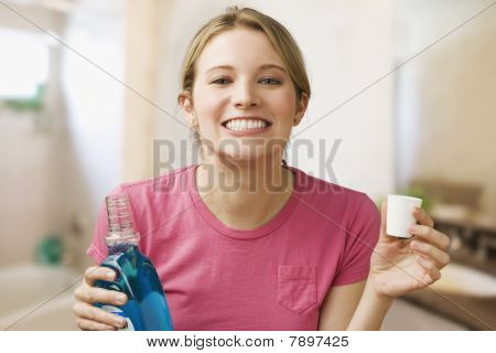 Woman Holding Mouthwash