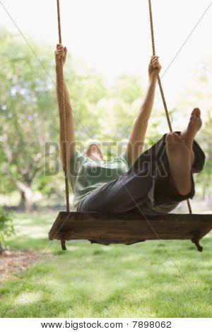 Woman Swinging on Swing