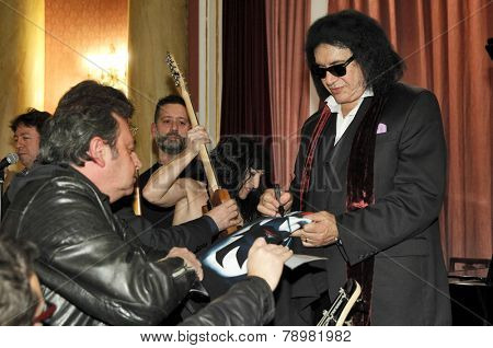 BARCELONA - DEC, 15: Guitarist and vocalist of a Rock band Kiss Gene Simmons, autograph signing during an event in Reial Cercle Artistic on December 15, 2014 in Barcelona, Spain