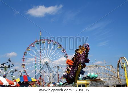 Amusement park rides on the boardwalk at the New Jersey shore poster