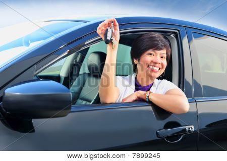 Woman with new car keys