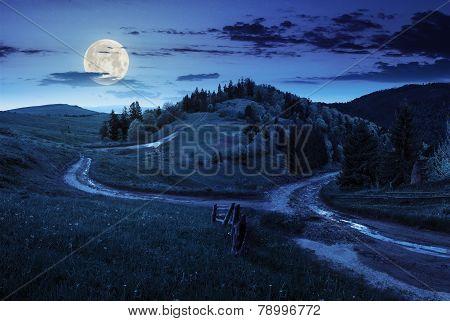 Cross Road On Hillside Meadow In Mountain At Night