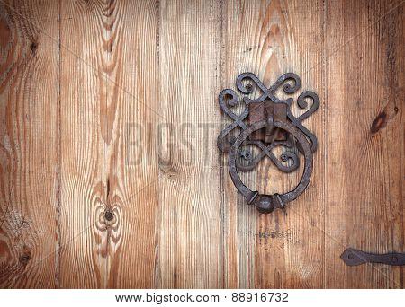 Old Rusty Doorknob And Wood Door
