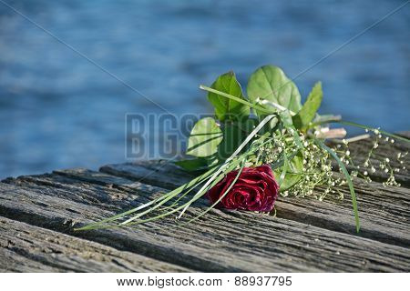 Last Love Greeting, Rose Bouquet On The Old Wooden Pier After A Burial At Sea