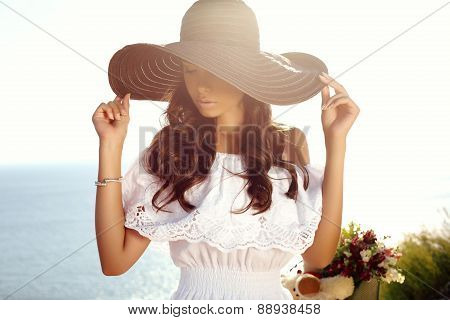 Beautiful Girl With Dark Hair In Elegant Dress And Hat