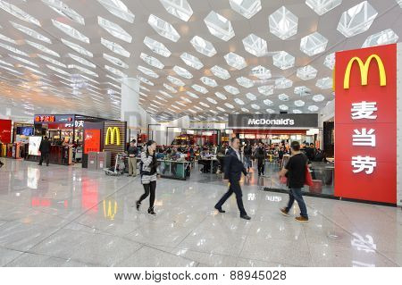 SHENZHEN, CHINA - FEBRUARY 16, 2015: McDonald's restaurant interior. The McDonald's Corporation is the world's largest chain of hamburger fast food restaurants