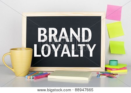Brand loyalty concept on chalkboard in office interior poster