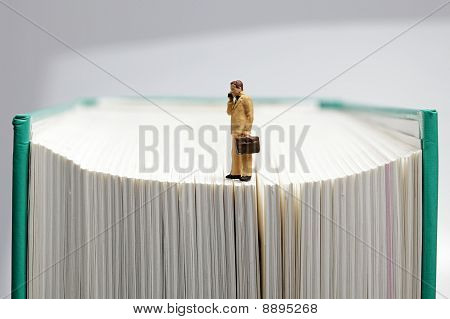 Businessman On A Book