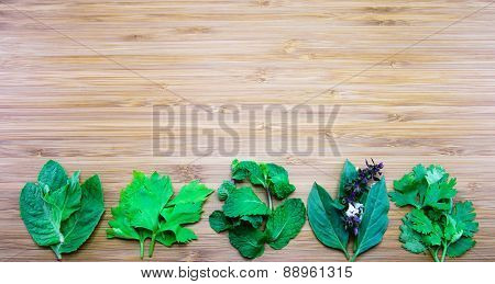Variety Of Aroma Leaves Of Thai Traditional Herbs On Wooden Background