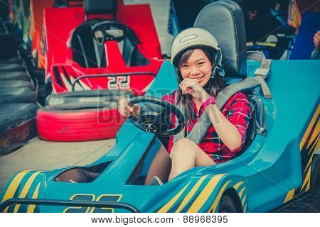 Cute Thai Girl Is Driving Go-kart From The Starting Point In Childhood Color