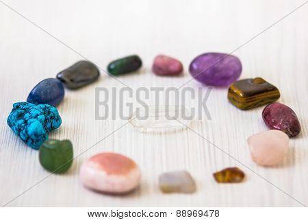 Crystals in shape of circle with clean quartz stone in middle, every with different energy for spiritual and body healing