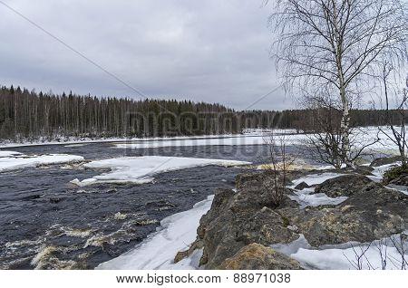 Rock ate the rapids in winter. Shuya river Karelia Russia. poster