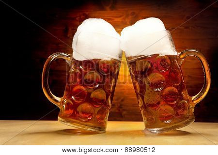 Five Beer Glasses On The Wooden Table