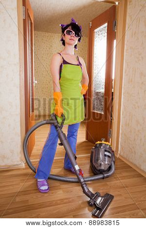 housewife costs in apartment with a vacuum cleaner