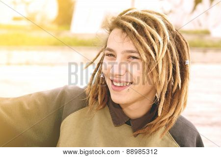 Portrait Of A Young Man With Rasta Hairs