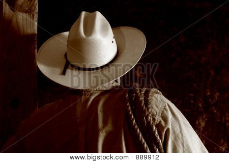 American West Rodeo Cowboy with Hat and Lasso