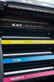 Close up of color laser printer toners cartridges poster