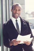 portrait of happy black man in business attire poster