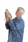 Proud senior man holding Wyandotte chicken on white background poster