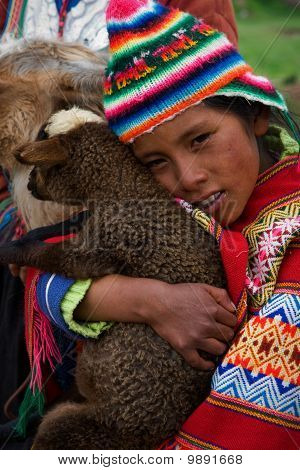 The Peruvian Girl And The Kid Of The Lama.