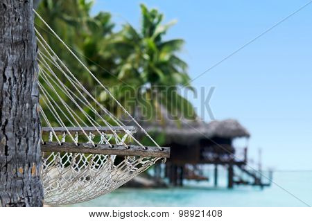 Hammock and reef Bungalows on tropical pacific ocean Island.