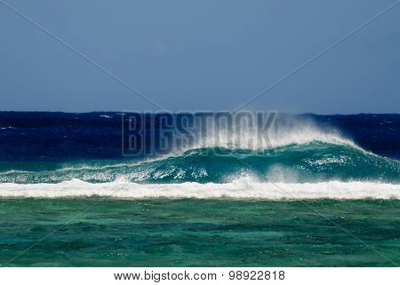 Seascape of a big wave break into a reef of a lagoon in Rarotonga Cook Islands.Photo by Rafael Ben-Ari/Chameleons Eye