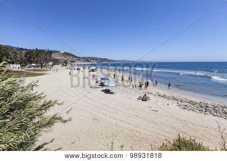 MALIBU, CALIFORNIA, USA - August 15, 2015:  Summer weekend beach goers enjoying Topanga State Beach in Santa Monica Bay.