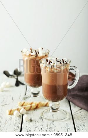 Glasses Of Hot Chocolate With Marshmallows On White Wooden Background