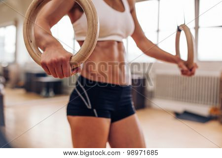 Crossfit Female Athlete Holding Gymnastic Rings