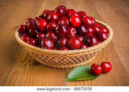 Sweet Cherry Berries (prunus Avium) In Wicker Plate