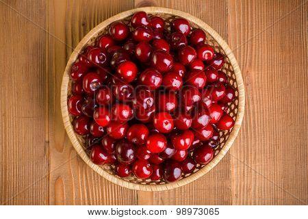 Top View Of Sweet Cherry Berries (prunus Avium) In Wicker Plate