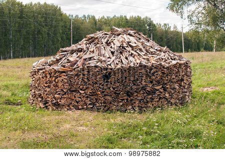 A Stack of Cleaving Birch Firewood in a Forest Glade on the Village Outskirts, Western Siberia, Russia poster